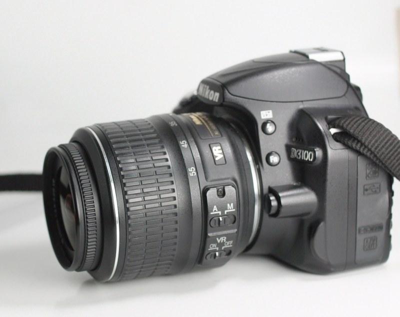 Nikon D3100 + Nikon 18-55mm VR